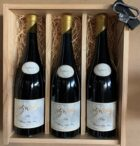 Wooden box with bottles of wine and a corkscrew